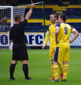 Tadcaster Albion left-back Paddy Miller was bizarrely cautioned for a foul after just 90 seconds
