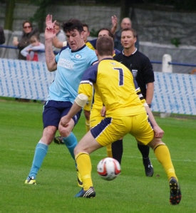 Barton Town Old Boys striker Scott Phillips looks to carve out a chance for his side